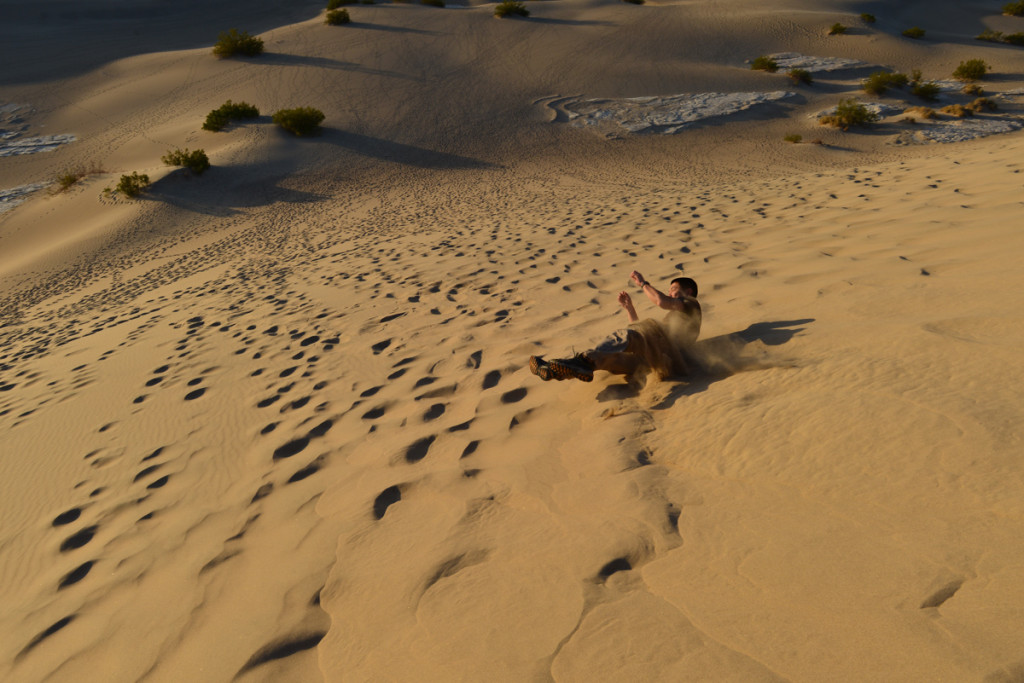 Me rolling down the sand dunes in Death Valley. Photo courtesy of Phillip (www.jimbojack.com).