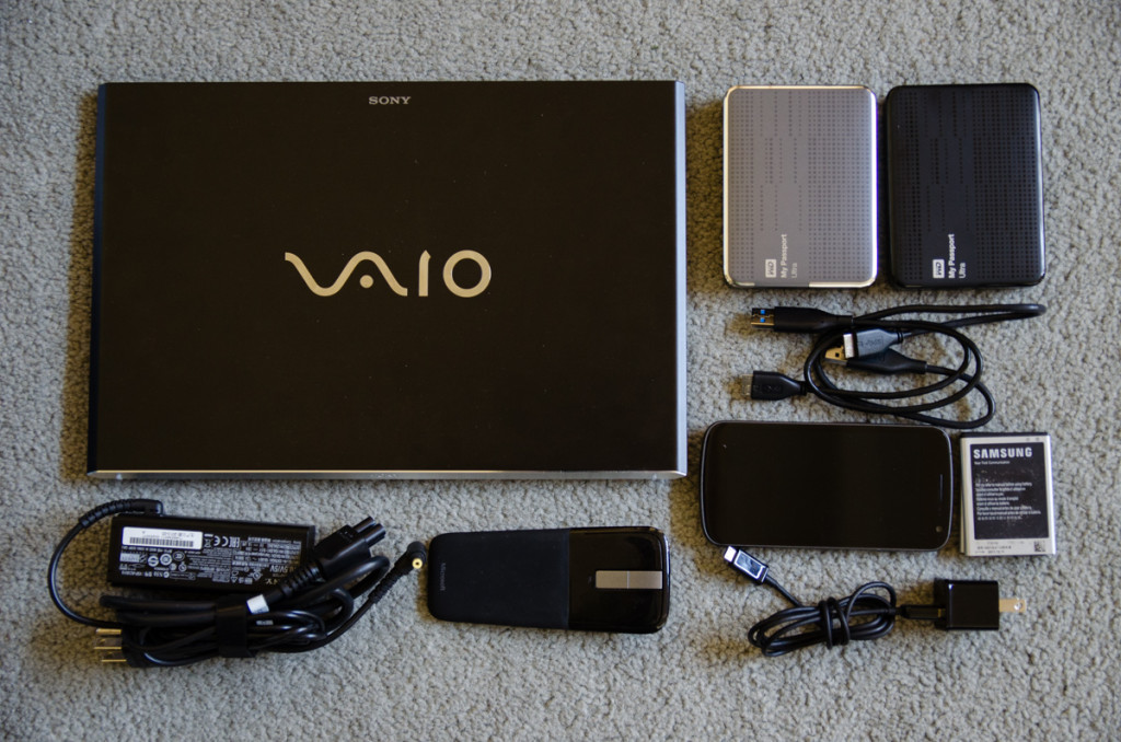 Laptop, 2 hard drives, cell phone, and mouse