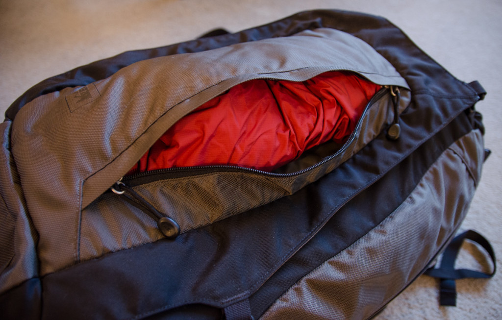 Rain jacket in front pocket for easy access