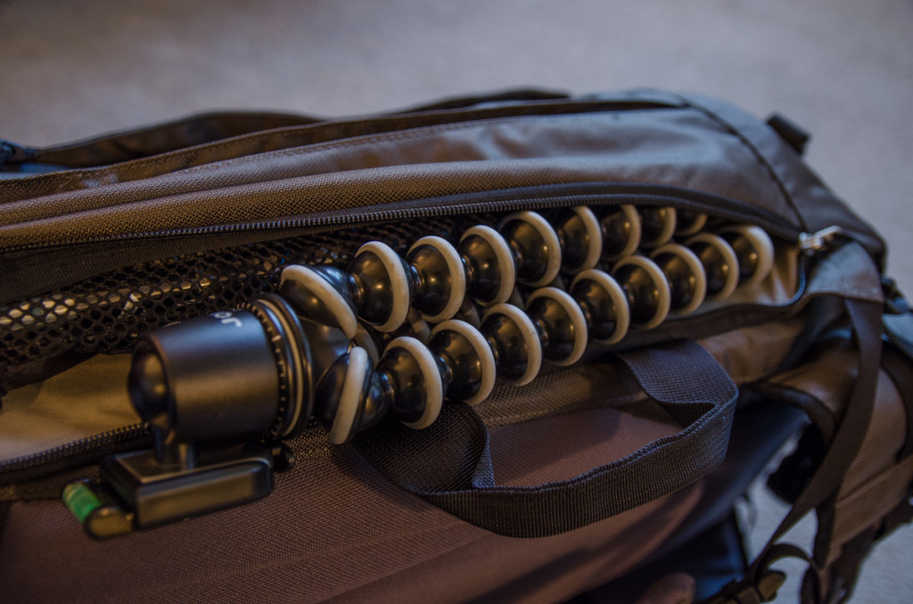 Tripod and hiking poles in one side pocket