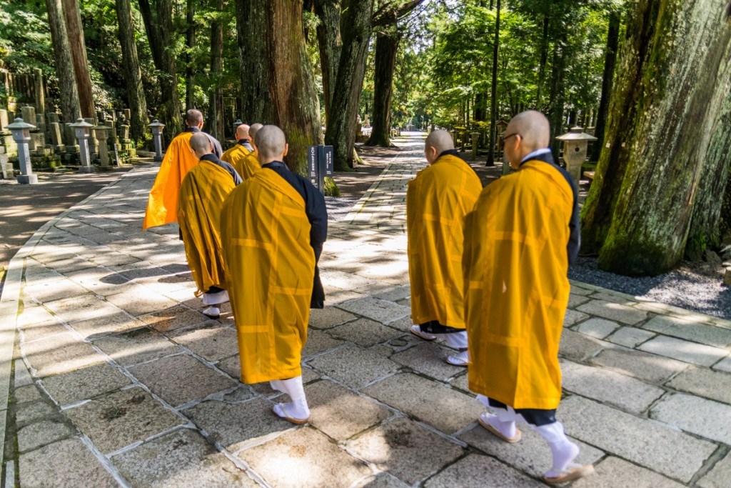 Monks walking into Okunoin Cemetery, Mount Koya