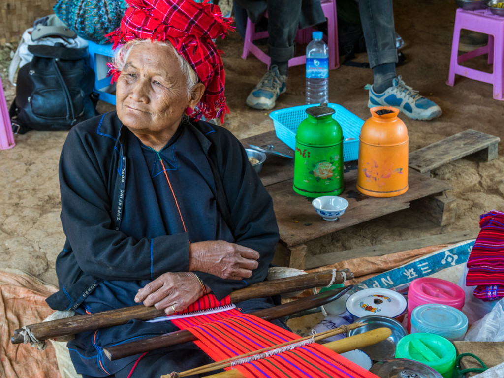 Local woman weaving bags, hike from Kalaw to Inle Lake