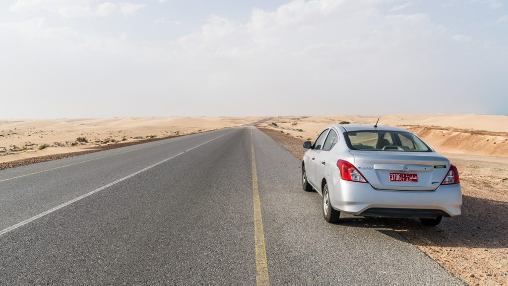 Driving on paved road through Sharqiya (Wahiba) Sands