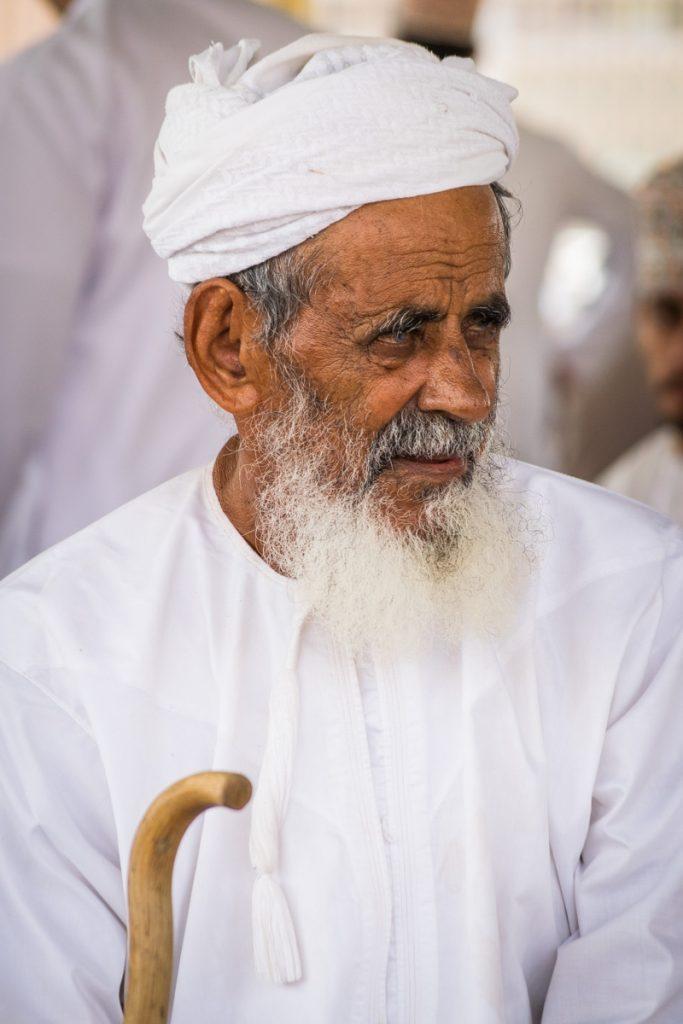 Man at Goat Market in Nizma, Oman