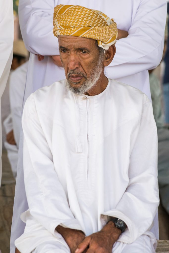 Man at Goat Market in Nizma, Oman